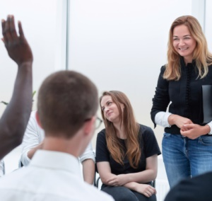 Manager leading employees in discussion